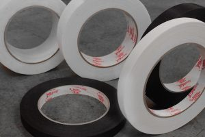 Adhesive and reinforcement tapes
